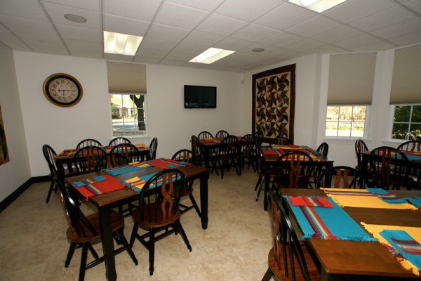 The Main House Lounge combines a kitchen, dining room and TV viewing area.